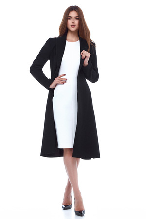 outerwear: Beauty woman model wear stylish design trend clothing natural organic wool cotton coat trench dress outerwear casual formal office style for work meeting walk party brunette hair makeup.