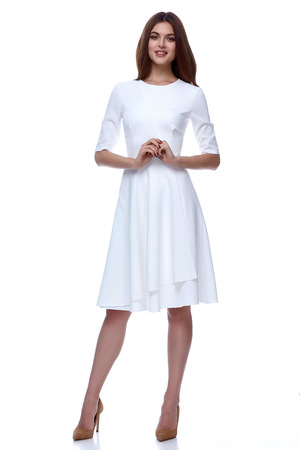 Woman in white short dress fashion catalog clothing beauty cute face summer spring collection style glamour model bride bridesmaid date passion mode vogue wedding dress brunette hair natural makeup.