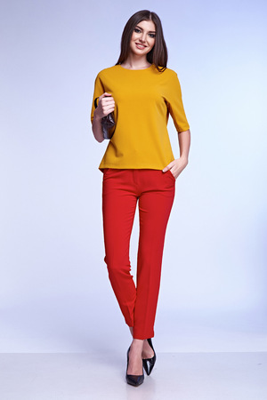 Sexy elegant woman natural beauty fashion style clothes casual formal suit lady in red silk romantic meeting date blouse and pants party style glamour model trend accessory bag dark hair make up.