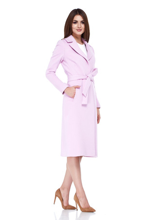 outerwear: Beautiful sexy woman lady wear casual style outerwear wool cashmere coat trench pink color pretty face dark natural hair spring autumn collection glamour model fashion clothes white background studio