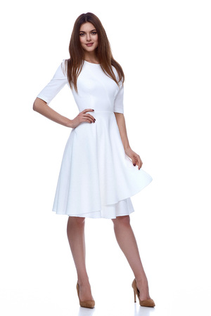 Woman in white short dress fashion catalog clothing beauty cute face summer spring collection style glamour model bride bridesmaid date passion mode vogue wedding dress. Stock Photo