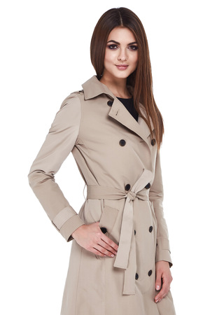 Beauty woman model wear stylish design trend clothing natural organic cotton coat trench dress outerwear casual formal office style for work meeting walk party brunette hair makeup white background. Stock Photo