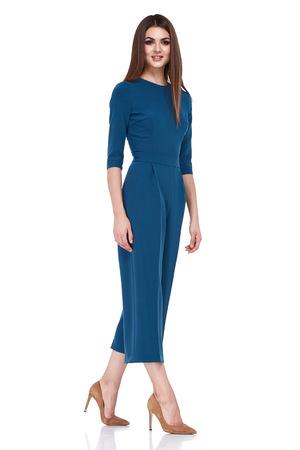 Fashion style woman perfect body shape brunette hair wear blue skirt blouse suit elegance casual beautiful model secretary air hostess diplomatic protocol office uniform stewardess business lady.