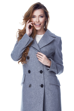 Beautiful sexy woman lady wear casual style outerwear wool cashmere coat trench grey color face smile natural hair spring autumn collection glamour model fashion clothes white background studio.