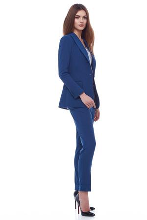 ファッション スタイル女性完璧なボディ形状ブルネットの髪摩耗青いズボン ブラウス スーツ エレガンス カジュアルな美しいモデル秘書空気ホステ