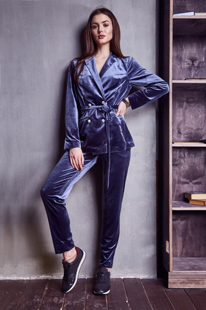 velvet dress: Beautiful sexy woman wear silk velvet suit clothes for businesswoman office style casual girl with dark hair fashion catalog lady perfect face cosmetic and body makeup meeting walk interior room.