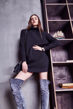 jackboot: Beauty woman model wear stylish design trend clothing natural organic wool cotton cashmere black dress jackboot casual formal office style for work meeting walk party brunette hair makeup accessory.