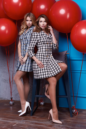 Two beauty business woman lady perfect body shape brunette hair wear clothes dress elegance casual style glamour fashion accessory shoes jewelry interior room passion party romantic big red balloon.