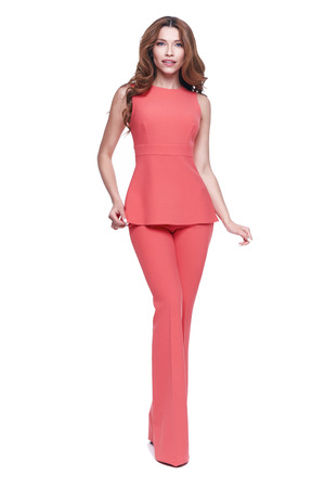 Beautiful glamour sexy woman dark brunette hair wear long silk or cotton fashion red suit blouse and pants shoes natural beauty perfect body shape clothes for meeting walk party date casual office.