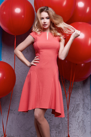 diplomatic: Beautiful woman lady spring autumn collection glamor model fashion clothes wear casual style for date silk suit blouse skirt dress pretty face blond natural hair accessory big red balloon romantic. Stock Photo