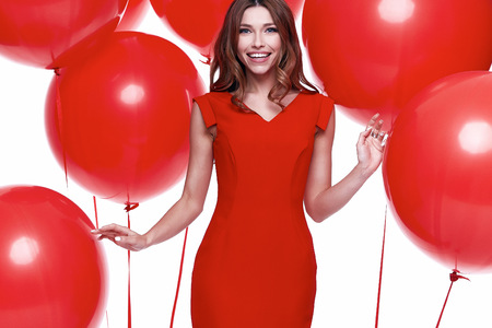diplomatic: Beautiful sexy brunette woman skinny business style dress diplomatic red color perfect body shape busy glamour lady casual style hostess etiquette balloon party celebrate birthday romantic surprise.