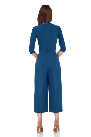 diplomatic: Fashion style woman perfect body shape brunette hair wear blue pants blouse suit elegance casual beautiful model secretary air hostess diplomatic protocol office uniform stewardess business lady. Stock Photo