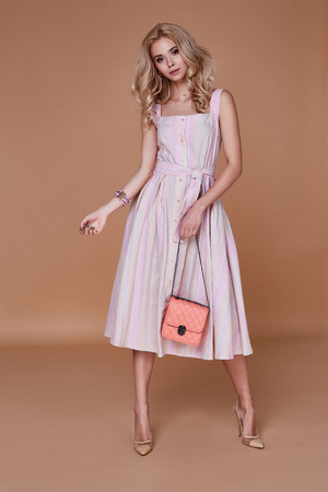 Beauty woman model wear stylish design trend clothing cotton dress casual formal office style for date walk  meeting walk party long blond hair lips makeup party businesswoman accessory bag fashion.