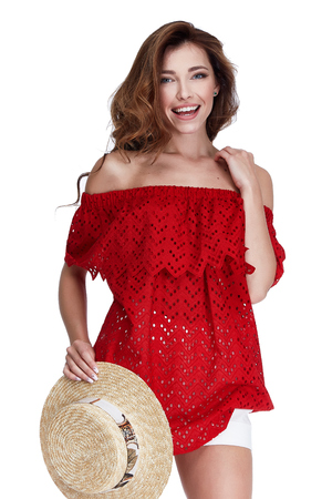 Sexy beautiful woman lady perfect body shape long hair makeup wear casual summer collection fashion clothes journey trip beach party romantic date red cotton blouse white short accessory straw hat. Stock Photo