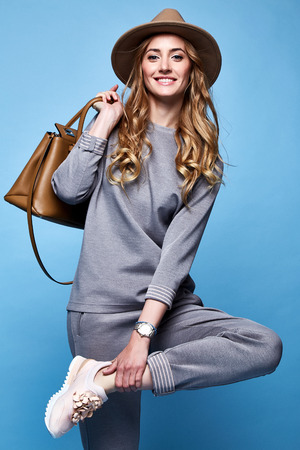 Beautiful woman sexy glamour fashion style wear clothes casual suit shirt and pants trendy accessory bag hat catalog spring collection casual businesswoman party date meeting makeup comfort sport. Stockfoto