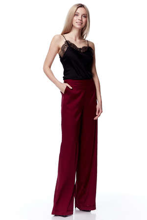 Beautiful sexy pretty fashion model blond hair woman wear bored red silk pants trousers and black blouse with lace style for party office clothes organic natural dress white background makeup lady.
