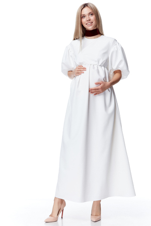 Beautiful elegant pregnant woman blond hair wear style fashion dress for mother hold in hand tummy wait for baby child new born pretty lady clothes for pregnancy white background collection heath.