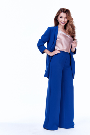 Portrait of beautiful business woman lady style perfect body shape brunette hair wear color suit blue elegance casual style secretary diplomatic protocol office uniform stewardess air hostess.