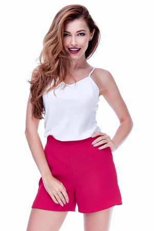 White background studio beautiful woman lady spring autumn collection glamor model fashion clothes wear casual style for date pink short silk blouse jacket skirt dress pretty face dark natural hair.
