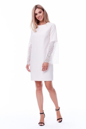 Blond hair woman wear office short dress code style pretty beautiful face model pose catalog of fashion clothes businesswoman white background studio secretary stewardess, air hostess uniform