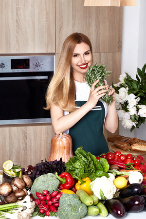 food supply: Beautiful woman housewife cook prepare kitchen culitaryl,delicious, tasty diet recipe made from fresh natural organic vegetable fruit, flavor cheese spicy spice, wear style fashion dress apron smile.