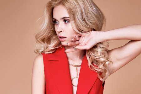 Beautiful sexy pretty girl wear red silk suit jacket and pants skinny body shape lady boss business woman skin tan long blond hair party style fashion cloches accessory bag necklace jewelry studio.