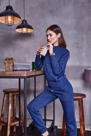 Beautiful business woman lady style perfect body shape brunette hair wear wool sport suit winter autumn collection elegance casual style glamour fashion accessory interior cafe student morning walk.