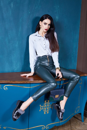 Beautiful business woman lady style perfect body shape brunette hair wear white blouse lather trousers shoes elegance casual style glamour fashion bag accessory jewelry interior door. Stok Fotoğraf - 91783778
