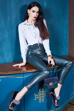 Beautiful business woman lady style perfect body shape brunette hair wear white blouse lather trousers shoes elegance casual style glamour fashion bag accessory jewelry interior door.