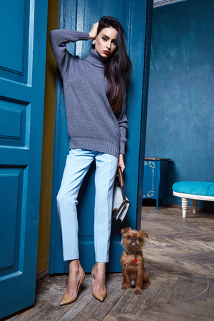 Beautiful business woman lady style perfect body shape brunette hair wear winter autumn collection elegance casual style glamour fashion bag accessory shoes jewelry interior door pets dog walk.