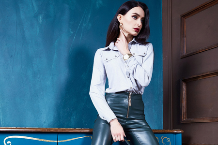 Beautiful business woman lady style perfect body shape brunette hair wear white blouse lather trousers shoes elegance casual style glamour fashion bag accessory jewelry interior door. Stok Fotoğraf - 91814772