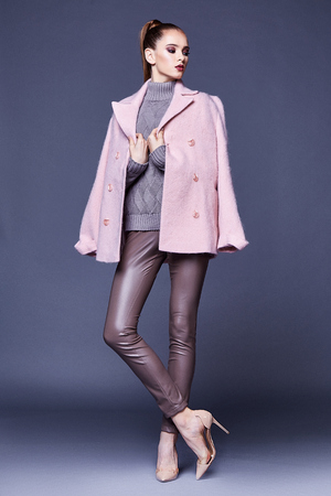 Woman wear business style clothing for office casual meeting outwear cashmere coat pink wool knitted sweater lather skinny pants fall collection casual formal for office beautiful face model glamour. Stock Photo - 91790428