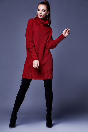 Sexy beautiful woman elegant lady wear casual clothes for every day red wool cashmere merino knitted dress fall winter collection lather black shoes fashion style glamour model wear trend brunette.