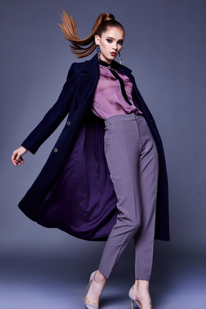 Beautiful sexy business woman wear black wool coat silk blouse and pants style for office dress cone uniform busy lady glamor makeup face cosmetic fall winter collection casual clothes fashion. 免版税图像