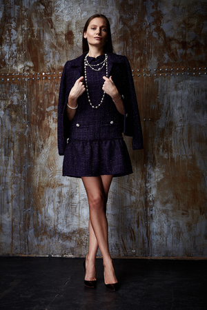 Beautiful sexy woman lady wear casual style outerwear wool cashmere coat trench black color skirt pretty face dark natural hair winter fall collection glamour model fashion clothes background studio.