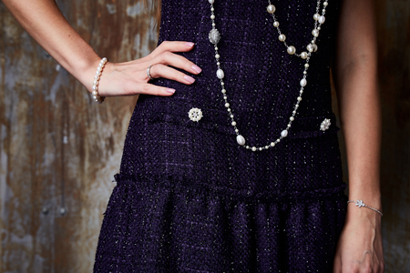 Sexy elegant details of luxury clothes dress with buttons diamond bright wool jacket hand manicure beauty salon hands cream skin care designer wear jewelry bracelet ring pearl gem .