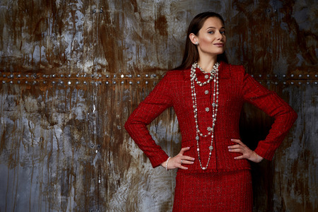 Background studio beautiful woman lady spring autumn collection glamor model fashion clothes wear casual style date red wool suit jacket button skirt dress code face natural hair accessory jewelry.