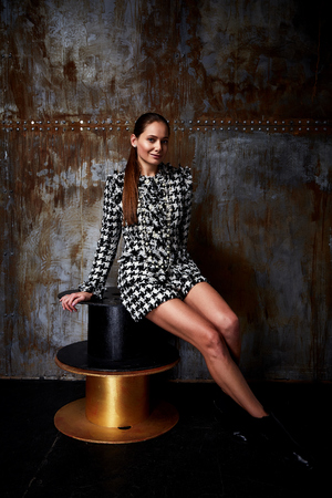 Fashion style woman perfect body shape brunette hair wear sexy elegance dress shorts suit wool casual clothes party office walk studio background collection glamor beautiful model business lady.