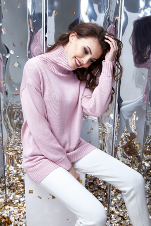 Mirror background sequins party fun celebrate beautiful woman lady spring autumn collection glamor model fashion clothes wear casual style for date sweater pants pretty face natural hair accessory.