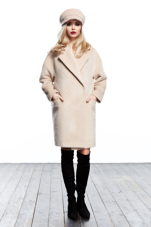 Business woman wear casual clothes style for winter autumn fashion model natural cashmere wool beige coat accessory hat blond hair glamour trend studio white background trench beautiful girl makeup. Stock Photo