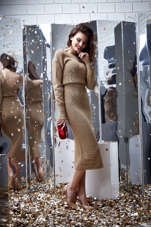 Sexy pretty fashion model brunette hair woman wear beige long dress shoe style for party holiday birthday clothes organic natural mirror sequins background makeup lady body skin care accessory bag.
