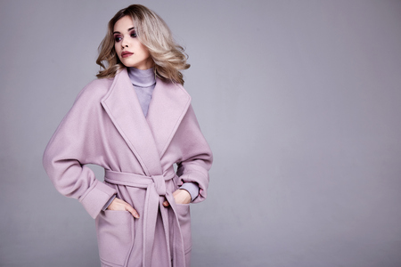 Portrait of beautiful sexy woman wear business style clothing for office casual meeting collection accessory cashmere wool coat jacket sexy glamor fashion model beauty face long blond hair body shape.