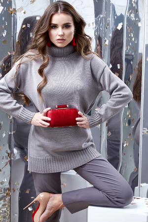 Beautiful sexy young business woman brunette hair luxury chic wear casual style for office grey  organic sweater trousers pretty face spring winter collection glamor model fashion clothes jewelry bag.