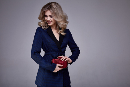Portrait beautiful business woman lady boss style perfect blond hair wear blue formal suit elegance casual style secretary diplomatic protocol office uniform stewardess air hostess accessory bag. Stock Photo