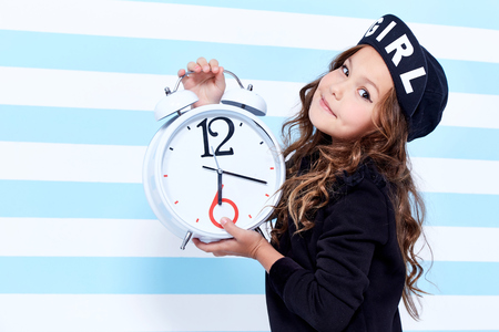 School small baby girl dress for schoolgirl pupil uniform beret socks hat fun smile curly hair toy  studies learning fashion stile clothes child childhood little model cute face hold big watch play.