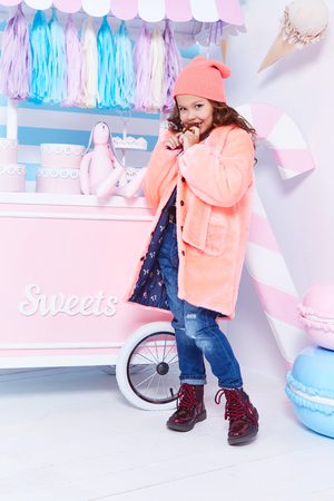 Clothes for kid jeans denim fur hat fashion style small little girl beautiful lady curly hair child funny cute face smile sweets baby shower party candy bar game room birthday eats chocolate play toy.