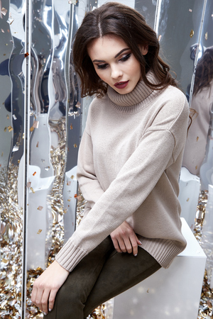 Portrait sexy brunette woman wear wool warm sweater winter spring collection pants accessory bag glamour model fashion dress catalog clothes date party walk makeup organic cosmetic jewelry mirror.