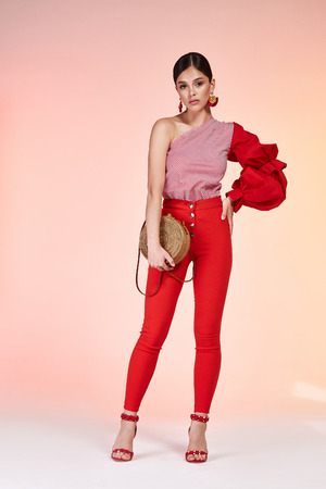 Beautiful sexy young business woman brunette hair with evening make-up wearing a suit top blouse pants high-heeled shoes  business clothes for meetings and walks summer collection perfect body shape. 스톡 콘텐츠 - 103026501