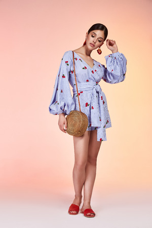 Pretty beautiful sexy elegance woman skin tan body fashion model glamor pose wear dress  short blue casual clothes party summer collection makeup brunette success accessory bag jewelry studio. Stock Photo