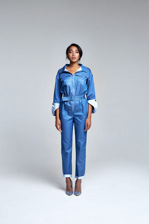 Beautiful woman business style collection party fashion clothes dress denim suit blue casual luxury wear for every day accessory model runway mulatto skin cosmetic for face body shape perfect lady. Stock Photo